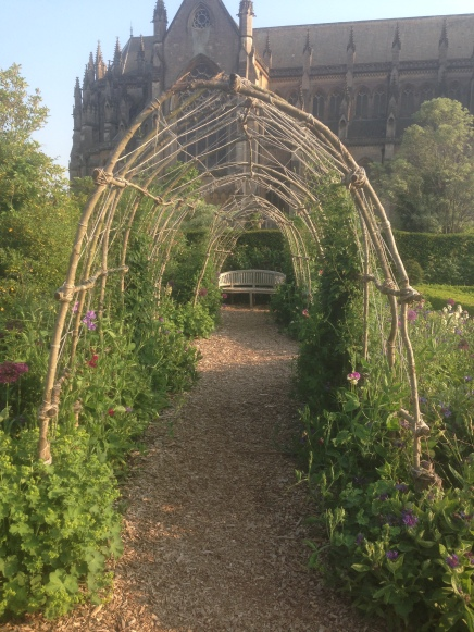 Sweet Pea arch overlooked by the Cathedral Church at Arundel Castle gardens.