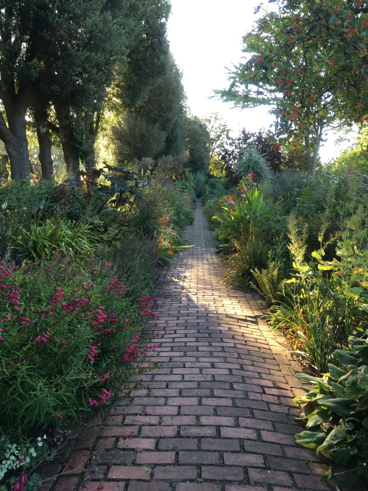 brick path with flower borders