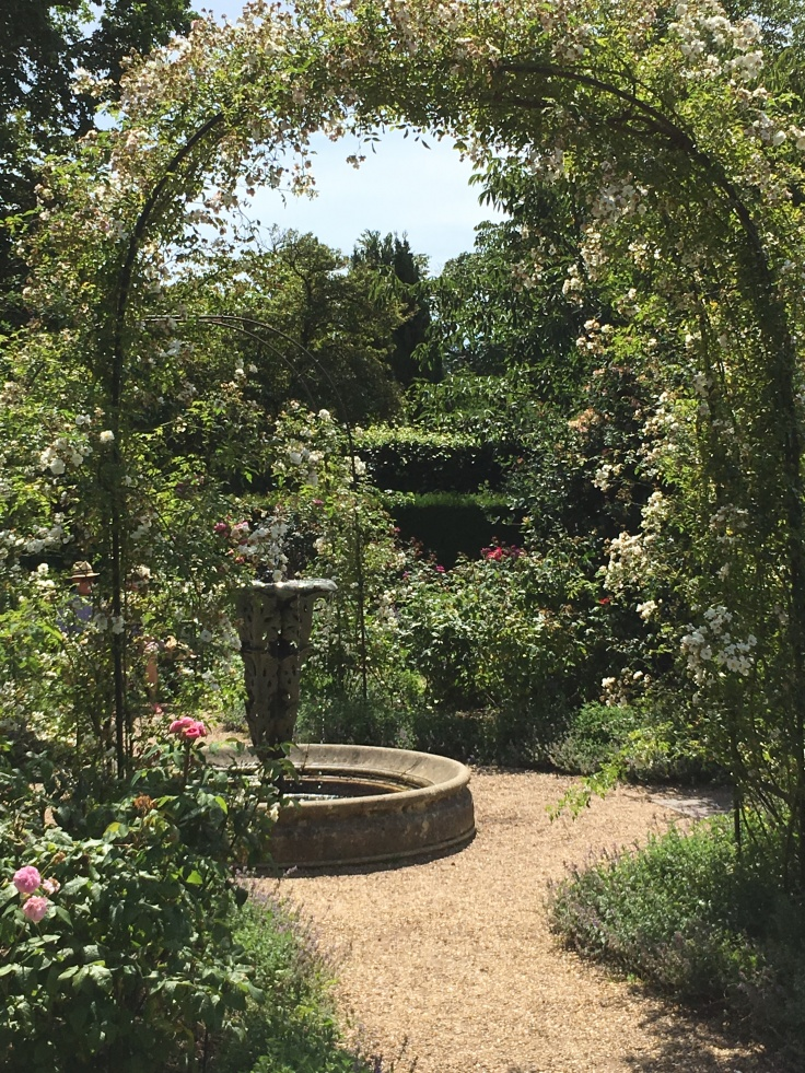 sundial and rose arches in the rose garden