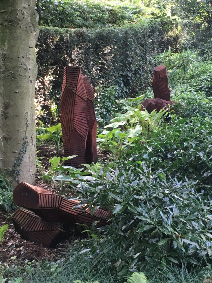 Redwood carved sculptures in garden