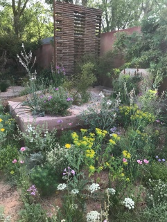 wispy planting & terracotta colours in the M&G Garden