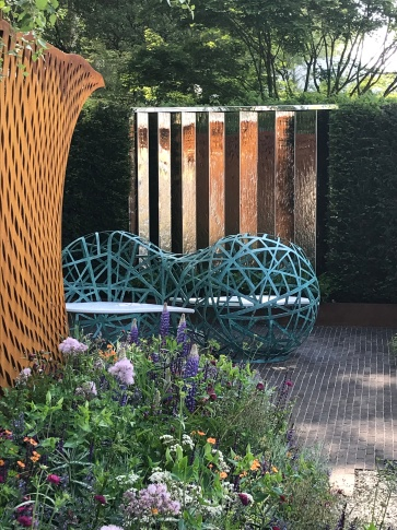 Corten Steel arch with copper and corian bench in the David Harber Garden