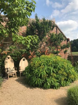 Wooden thrones in Cowdray walled garden